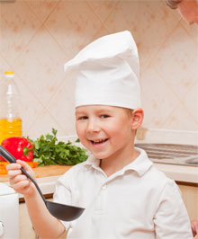 Boy tasting own cooking